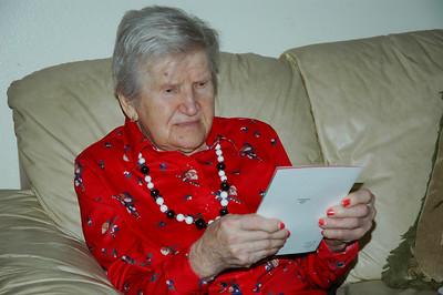 Nellie looking at Edmund's card-Dec 2010_5655