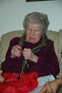 Nellie tying scarf-B-Day Sep 2010