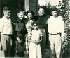 Left to right: Conrad Pavellas, Genevieve Harpending Palladius, Artemis Pavellas, Diane Pavellas, Nestor Palladius, Ronald Pavellas. This was in front of the cottage we rented on Hillegass Avenue in Berkeley. I believe this was a family gathering in 1953 to celebrate my graduation from Berkeley high, the same school dad graduated from. Nestor would have been 28 years old here, and I was 16.
