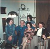 This is in the home of Mary, my second wife, and me, in Southern California. Left to right: Timmie Palladius, Joseph Cogan (Mary's father), Mary Pavellas in the back, Artemis Pavellas and Nestor Palladius. The date would probably be around 1974.