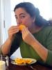 Susie enjoys an orange from Redwood City