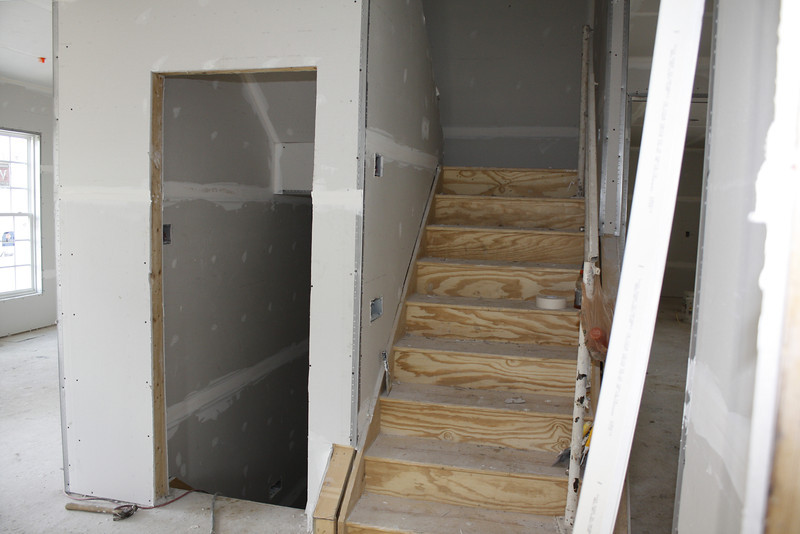 left is stairs to basement, right stairs to 2nd floor