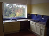 Large breakfast kitchen that overlooks the terrace and the garden. There are mote cupboards out of shot to the right.