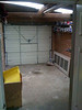 Inside of garage from the utility room beside kitchen.