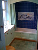 Bathroom, the bath is enclosed. (There is a technical term for it but we've no idea what it is...)