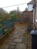 The garden terrace. Looking from the rear door, past the kitchen window to the french doors.