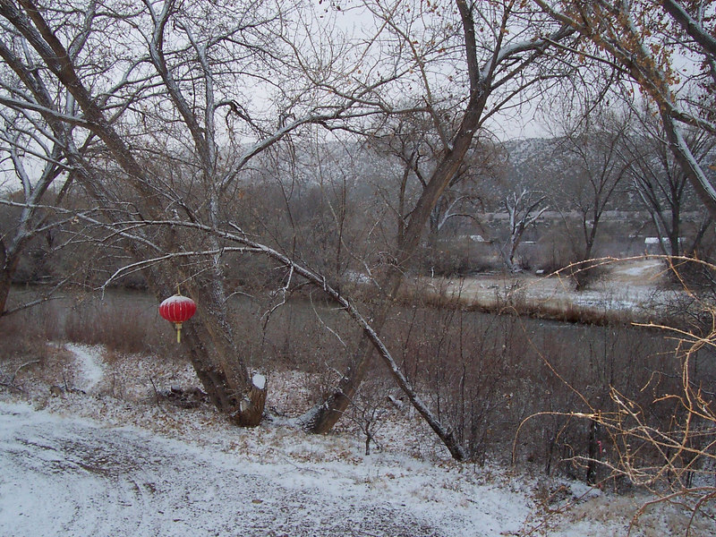 No... the Rio Grande hasn't frozen yet. Our Chinese lantern is collecting snow though.