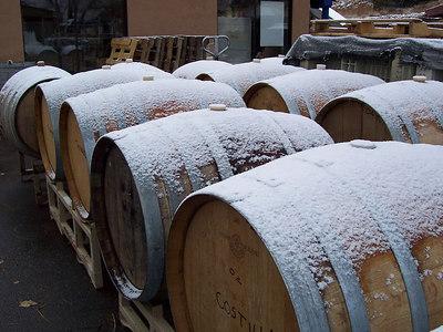 Snow-covered wine barrels.