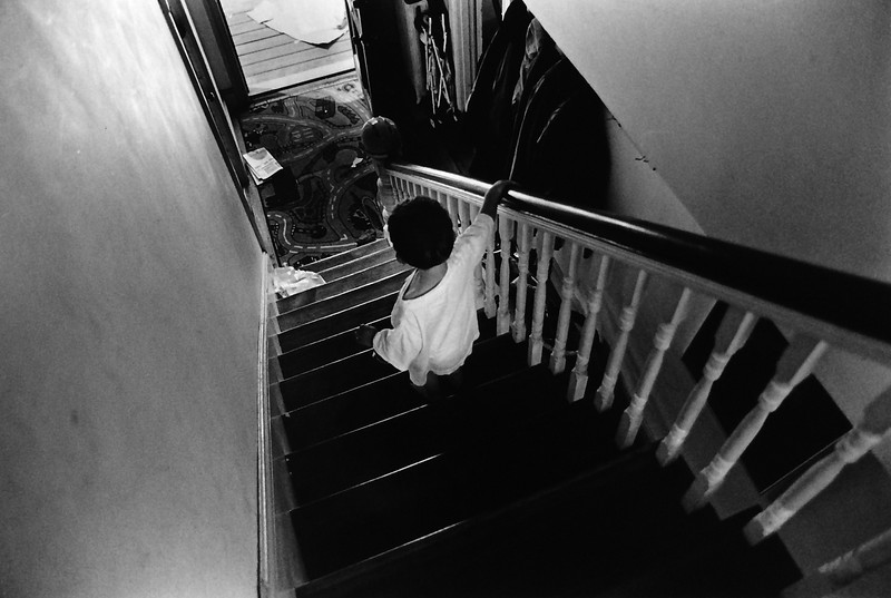 Kevin walking down the stairs at 6 Houlton St. Portland, ME. Kevin liked to quietly leave whatever room we were all in to go on 'adventures.'