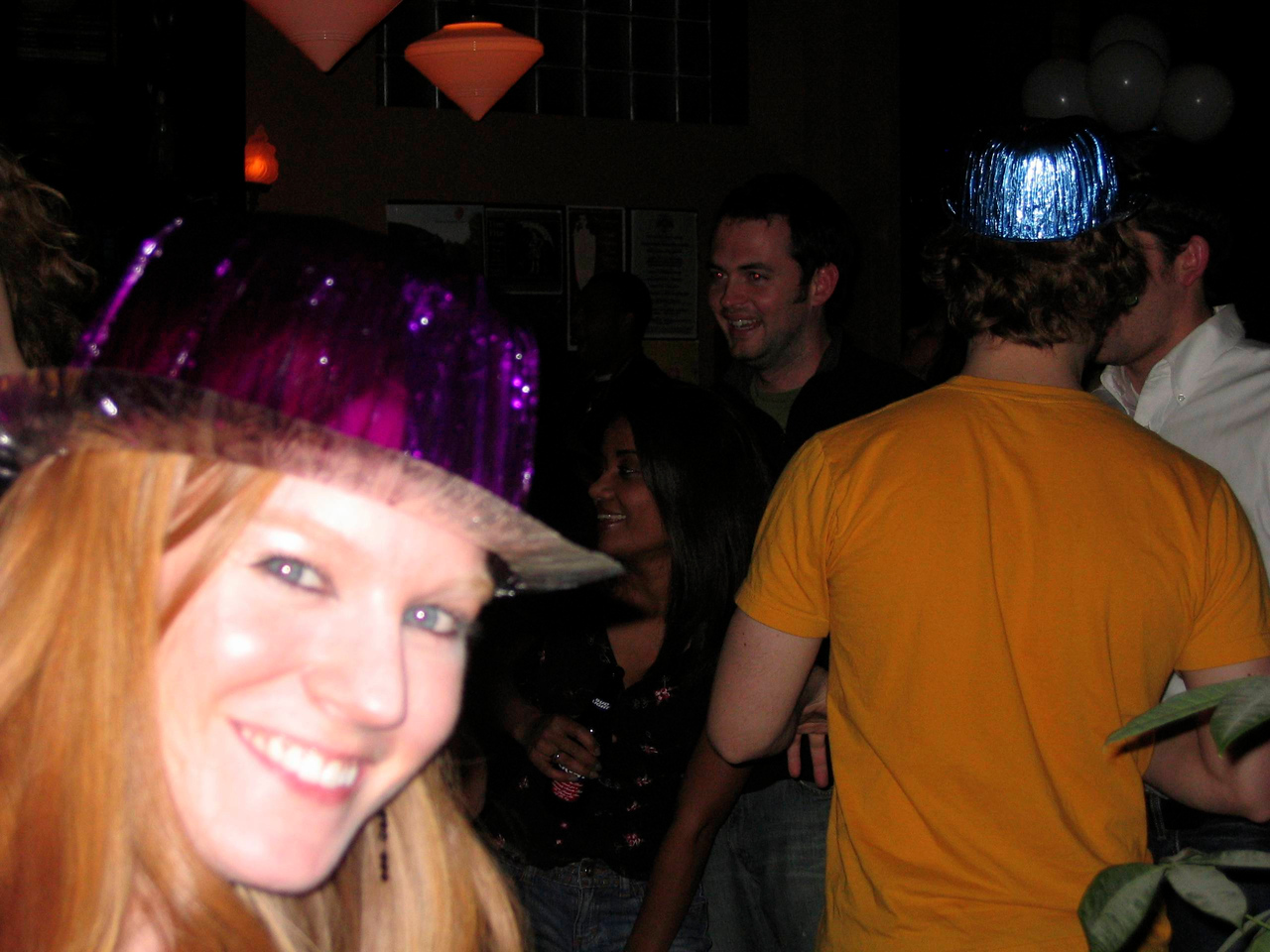 """Erica w/ the guy (in yellow) to whom she said he had a """"big head"""""""