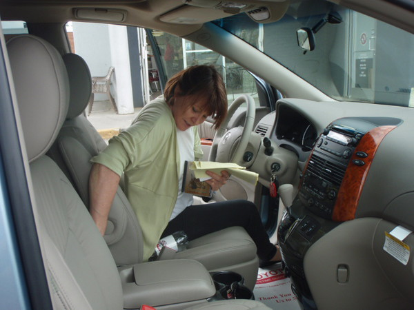 Pat taking delivery of her new 2009 Toyota Sienna