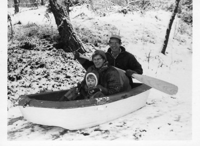 1974. Sliding down the driveway in a boat!  My mother and I had been sledding there with my children; Nick came out to join us, but all the sleds were in use.  He went into the garage and pulled out this boat.