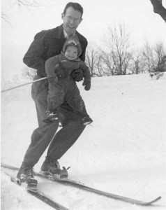 "My father sharing the love of skiing with the next generation (me).  Photo by John ""Ace"" Nutter, winter 1945.  See my writing about this photograph: ""Learning to Ski."""