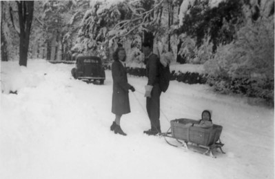 """Nichols family en route to Pine Knoll, Christmas 1945.""  I'm on the sled; my sister (7 months) is in the pack."