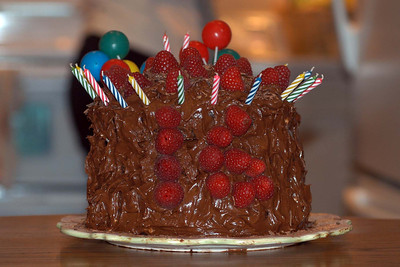 What a birthday cake ... a triple deck chocolate sensation with Pat's 16 raspberry and candle applique.  Looks like the cake developed an outgrowth ailment or a fortress with waiting cannons.