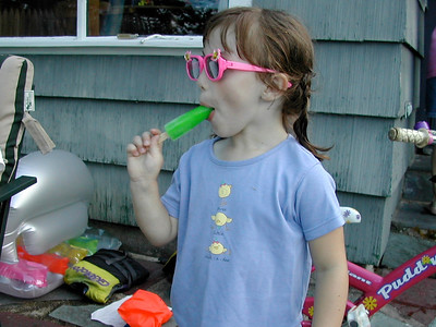 Emily, sunglasses, popsicle at camp.