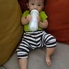 Noah holding his bottle.