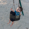 Noah riding a swing at Acorn park