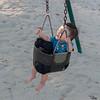 Noah riding a swing at Acorn park