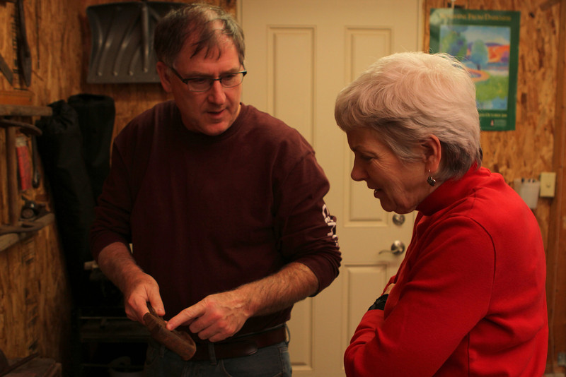 Gary shows Sarah a tool which helps replace and repair a link chain.