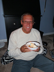 Dennis at home with birthday cake, ice cream, and candle to make a wish