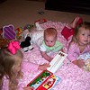 Camden's reading Madline and Claire a book.  What a good babysitter!!