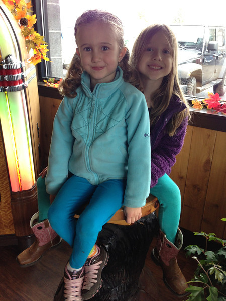 Norah & Violet waiting for chocolate chip pancakes at Black Bear Diner.