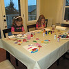Painting dough ornaments.