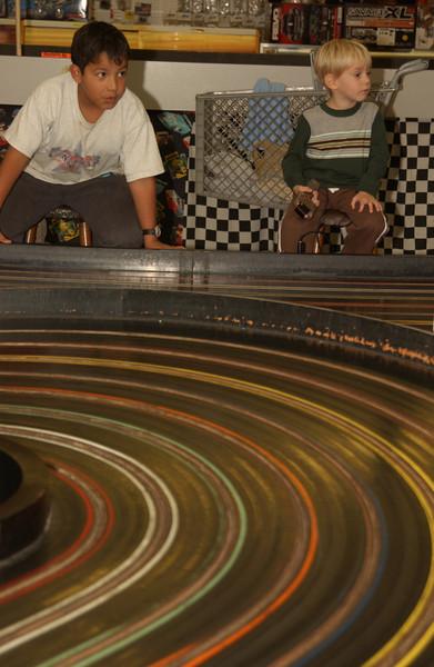 Christian & Logan racing cars at the Q