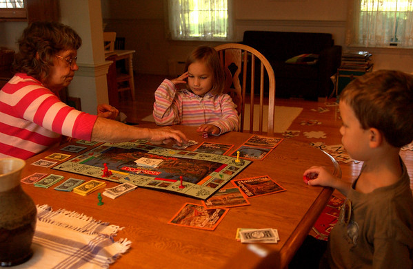 Mom, Abigail & Dominic playing Monopoly
