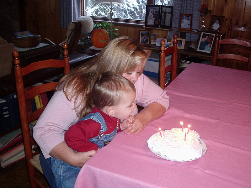 Hugh helps his mother blow out the candles.  Why four candles? Because there were four pink candles in the box.  Pink is his mother's favorite color.