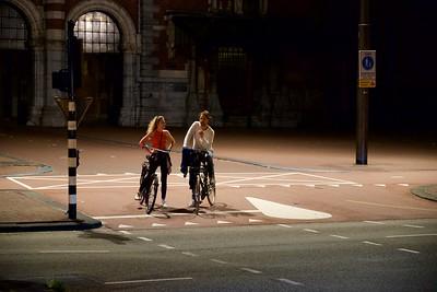 Lone late night cyclists.