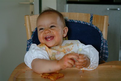 Happy after a piece of pizza.