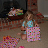 Opening her first present.