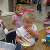 Sharing her birthday cookies with her class.