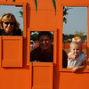 GiGi, Papa, and Hallie in the peeking out of the pumpkin.