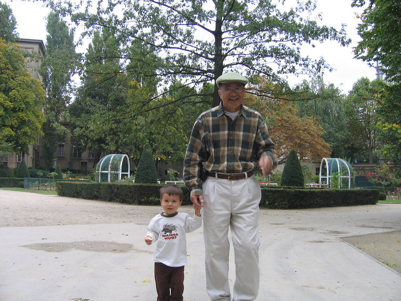 Grandpa and Michael walking in the park