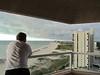 Ken watching a storm coming, Crescent Beach condo, Clearwater Beach, FL, 10/4/2012