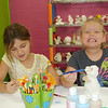 Camden invited a couple of friends to paint at the pottery place.