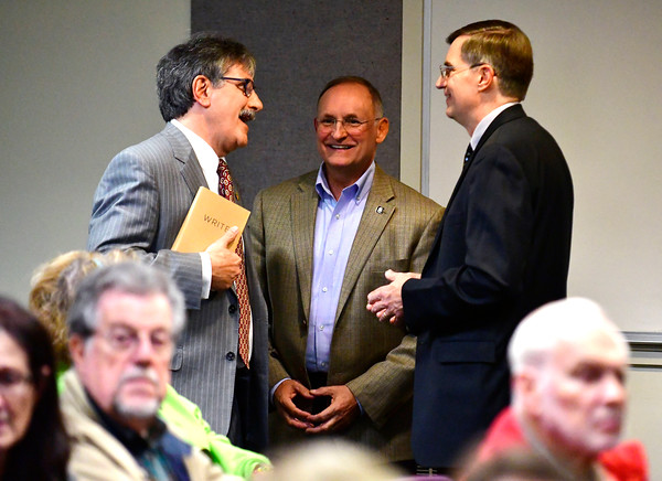 10/11/2016 Mike Orazzi   Staff State senate candidate Mike Nicastro talks with state senator Henri Martin talks with moderator Richard Williams before Tuesday evenings debate held at the Plainville Library.