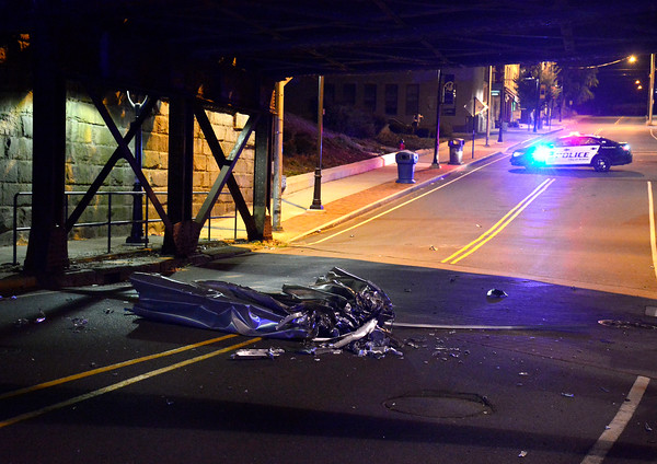 10/11/2016 Mike Orazzi   Staff The top portion of a box truck that was too high for the railroad underpass on Main Street Tuesday night. The truck and driver fled the scene and the street remained closed for a several hours.