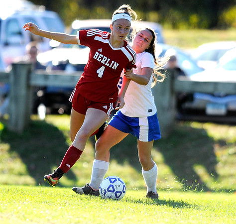 10/11/2016 Mike Orazzi   Staff Berlin's Tess Atkinson (4) and Bristol Eastern's Jenny Soucy (3) during Tuesday's soccer match in Bristol.