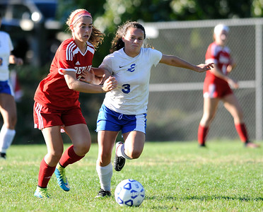 10/11/2016  Mike Orazzi | Staff Berlin's Julia Sisti (3) and Bristol Eastern's Jenny Soucy (3)  during Tuesday's soccer match in Bristol.