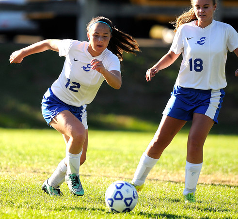10/11/2016 Mike Orazzi   Staff Bristol Eastern's Leah Policarpio (12) and Megan Perry (18) during Tuesday's soccer match in Bristol.