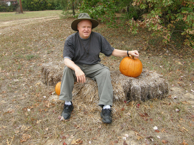 Ronnie Humphries pauses beside his pumpkin.