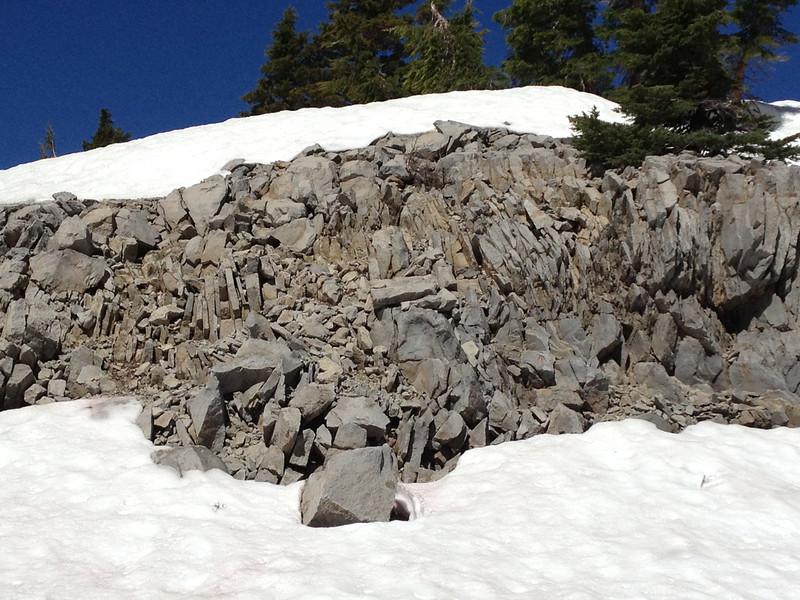Big rocks and snow, trees.
