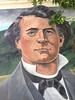 Issac Roop, co-founder of Susanville, mural on wall.