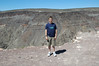 A canyon in Death Valley.  A deep canyon near which Cooper is at the edge.