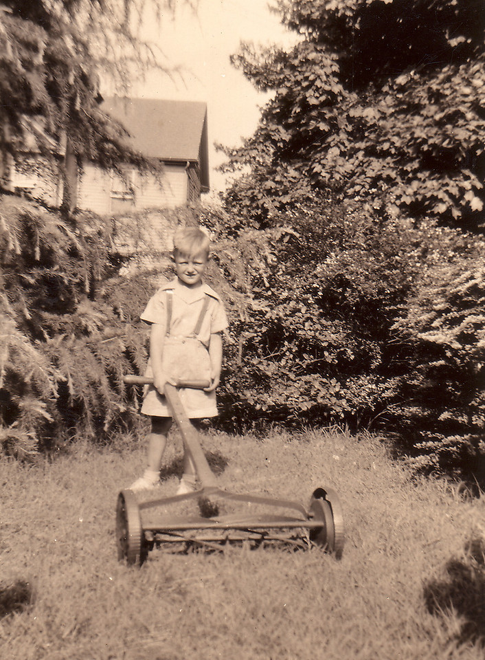 "Tommy White mowing the lawn. He's the son of Adelaide Carlisle and Vernon ""Kikie"" White. First grandson of Arthur Carlisle and Mamie Downing Carlisle."