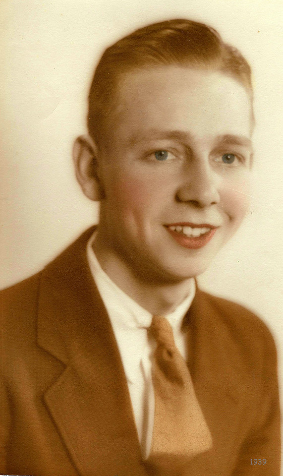 """Forrest E Coker age 20 - The back of this photo his wife wrote, """"Bud Coker age 20 - When we first started dating?""""  This type of photography was shot in Black & White, then the photographer would lightly hand color the eyes skin and lips."""